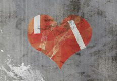 Damaged heart on old paper Royalty Free Stock Image