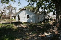 Damaged Home Ninth Ward. The flood waters of hurricane Katrina pushed this Ninth Ward house off it's foundation. When the waters receeded the house settled on Stock Photography