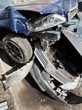 Damaged hoods of cars during road accident Stock Photos