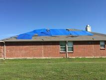 Damaged house by tornado Stock Photo