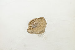 Damaged house wall with a hole in the plaster Royalty Free Stock Image