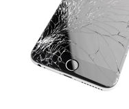Damaged iphone on white background. Moscow, Russia - November 22, 2015: Photo of iPhone 6 plus with broken display. Modern smartphone with damaged glass screen Royalty Free Stock Photography