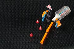 Damaged lan cable scene. The damaged lan connection cable plug and maintenance figure miniature model represent the computer business and technology concept Royalty Free Stock Photo