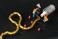 Damaged lan cable scene. The damaged lan connection cable plug and maintenance figure miniature model represent the computor business and technology concept Royalty Free Stock Photos