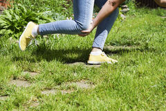 Damaged leg muscles women. Walking on a Sunny summer day, the trauma and danger Royalty Free Stock Image