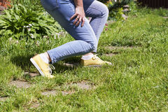 Damaged leg muscles women. Walking on a Sunny summer day, the trauma and danger Royalty Free Stock Photography