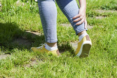 Damaged leg muscles women. Walking on a Sunny summer day, the trauma and danger Stock Photo