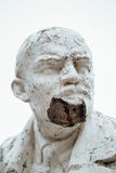 Damaged Lenin statue, peeling vintage paint. The concept of syst. Em failure, closeup portrait Royalty Free Stock Photo