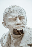 Damaged Lenin statue, peeling vintage paint. The concept of syst. Em failure, closeup portrait Stock Photos