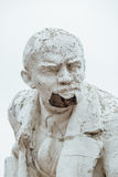 Damaged Lenin statue, peeling vintage paint. The concept of syst Stock Photography