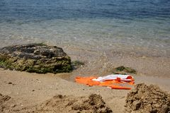 A damaged life jacket. In the sand floats on the seashore stock photography