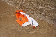 A damaged life jacket. In the sand floats on the seashore royalty free stock image
