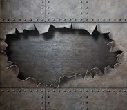 Damaged metal armor with torn hole steam punk royalty free stock photography