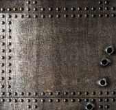 Damaged metal background with bullet holes. Old damaged metal background with bullet holes Stock Photo