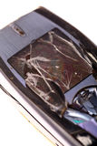 Damaged mobile phone Stock Images