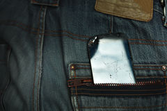 Damaged Mobile In A Pocket Royalty Free Stock Image