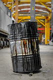 Damaged oil drums in industrial interior Royalty Free Stock Photo