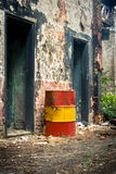 Damaged oil drums in industrial interior Stock Photos
