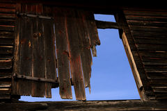 Damaged Old Barn Wood Door over Blue Sky Stock Photos