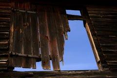 Damaged Old Barn Wood Door over Blue Sky Stock Photos