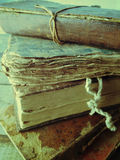 Damaged old books stacked. Vintage books, some tied with string, in a pile Royalty Free Stock Photography