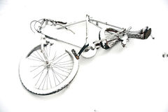 Damaged old bycicle covered by snow Royalty Free Stock Image