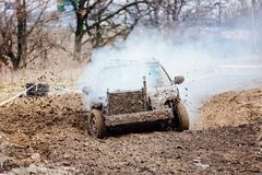 Damaged old car racing with broken engine Royalty Free Stock Photos
