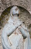 Damaged old religious statue of Virgin Mary stock images