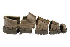 Damaged old shoes isolated on white Royalty Free Stock Image