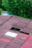 Damaged old tiles roof, need to replacement Stock Photo