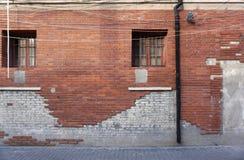 Damaged orange wall tiles in brick pattern Royalty Free Stock Images