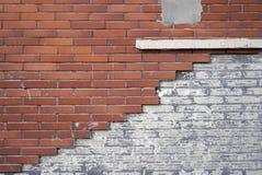 Damaged orange wall tiles in brick pattern Royalty Free Stock Photo