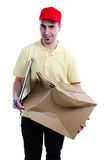 Damaged parcel. Delivery man scared for having damaged the parcel that distributes isolated over white background Stock Photos