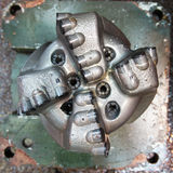 Damaged PDC drilling bit Stock Photography