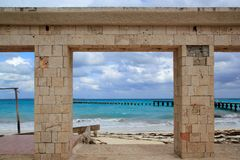 Damaged pier and beach after hurricane tropical Royalty Free Stock Photography