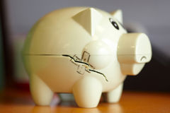 Damaged piggy bank Stock Images
