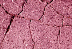 Damaged pink toned asphalt texture. Abstract background and texture Royalty Free Stock Photo