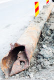 Damaged pipe. Close-up of a rusty blown up pipe Royalty Free Stock Image