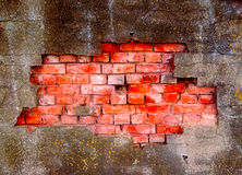 Damaged plaster on brick wall. Damaged plaster on the brick wall Royalty Free Stock Images