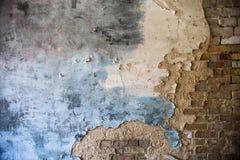 Damaged plaster on the brick wall Stock Photos