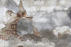Damaged plaster of a brick wall Stock Photos