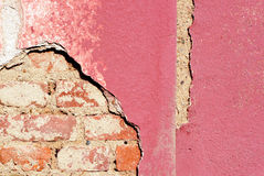 Damaged plaster house. Royalty Free Stock Images