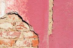 Damaged plaster house. Royalty Free Stock Images