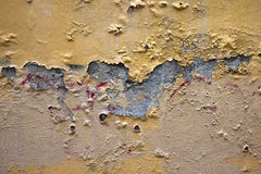 Damaged plaster. Useful image also to express the concepts of: aging, decadence, and so on Royalty Free Stock Image