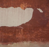 Damaged plaster. Wall with damaged plaster red Stock Photo