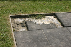 Damaged playground safety surface tiles Royalty Free Stock Photo