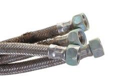 Damaged plumbing hoses Stock Photography