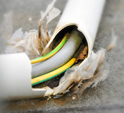 Damaged power cord. Maintenance of an damaged power cord stock photography