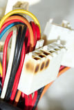 Damaged power line socket Stock Photos