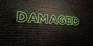 DAMAGED -Realistic Neon Sign on Brick Wall background - 3D rendered royalty free stock image. Can be used for online banner ads and direct mailers Royalty Free Stock Image